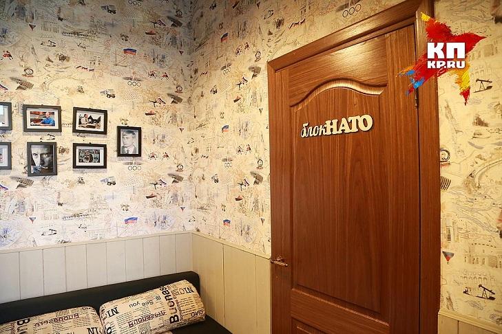 На Росії відкрили кафе Путіна: як відвідувачі плюють в постер з Обамою - фото 4