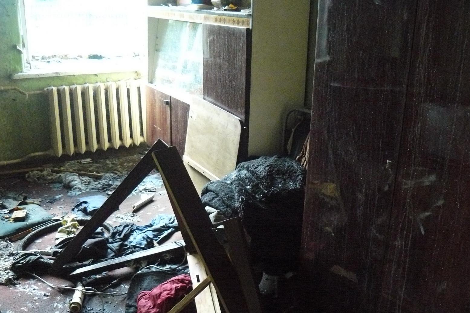 На Харківщині чоловік ледь не спалив матір  - фото 1