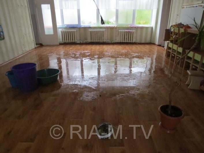 Дощ затопив дитсадок у Мелітополі - фото 4