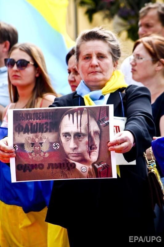 У Мілані Путіна подратували жовто-синіми прапорами (ФОТО) - фото 4