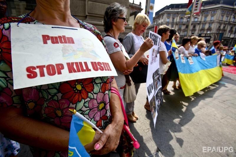 У Мілані Путіна подратували жовто-синіми прапорами (ФОТО) - фото 1