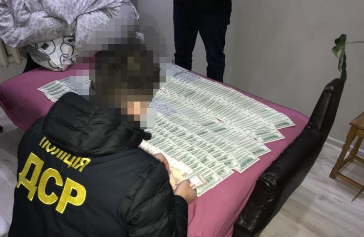 Поліція вилучила 50 тис. доларів у банди…